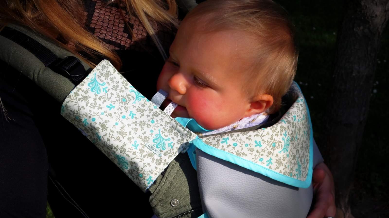 Accessoire pour portes-bébé: protège bretelle porte bébé